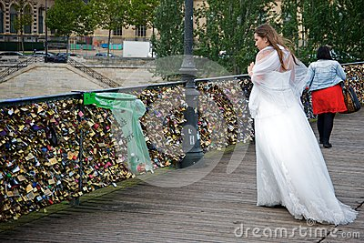 Bride looking for her love padlock Editorial Photo