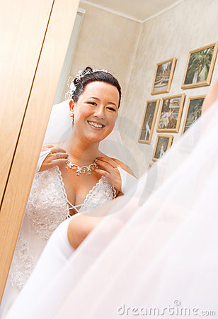 Bride looking at her reflection