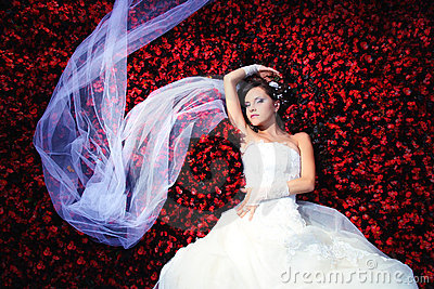 Bride with a lot of flowers