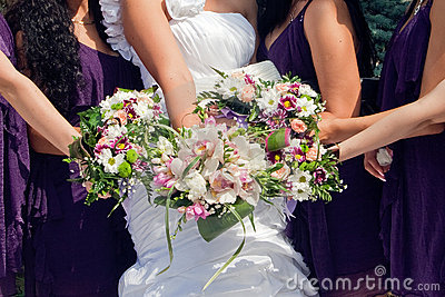 Bride and  maids of honor  with bouquetes