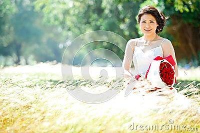 Bride on meadows field