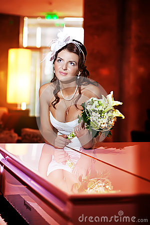 Bride next to the piano