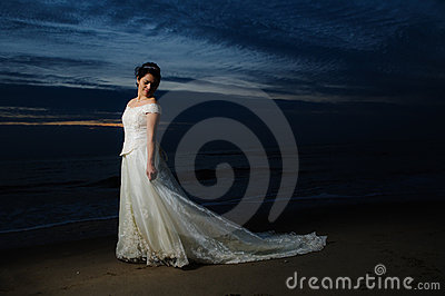 Bride at night by shore
