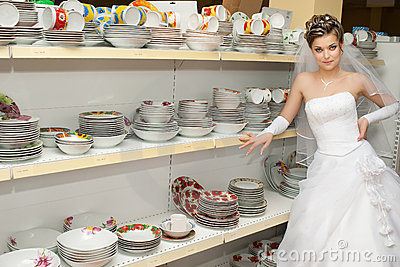 Bride in plates section of a store