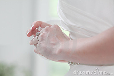 Bride playing with Engagement Ring