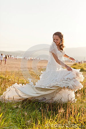 Bride playing with messy dress