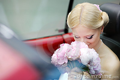 Bride portrait in a car