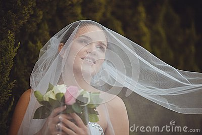 Bride portrait over green trees outdoor