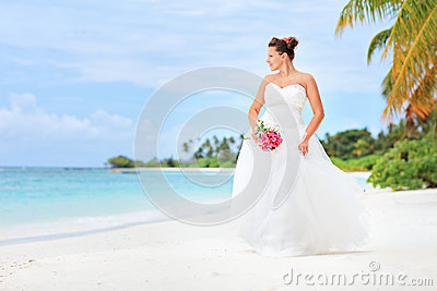 A bride posing on a beach in Maldives island