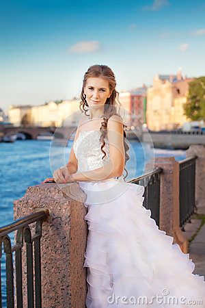 Bride posing outdoor near the river