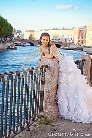 Bride posing outdoor near the river