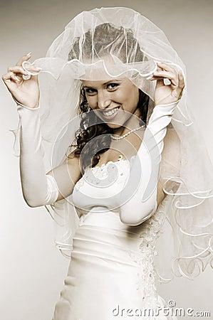 Bride raise her bridal veil