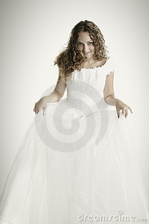 Bride raising dress skirt
