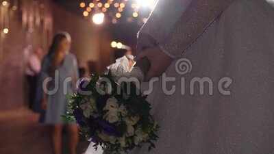 Bride ready to throw bridal bouquet at the wedding party.  stock video footage