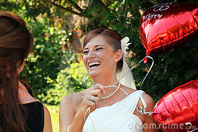 Bride with red balloons