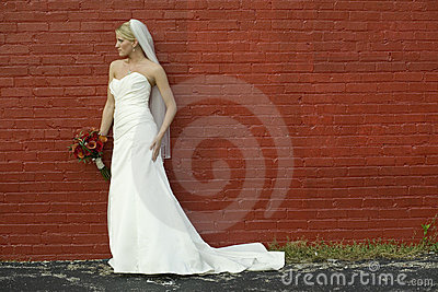 Bride on red brick wall