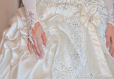 Bride s hands on wedding dress