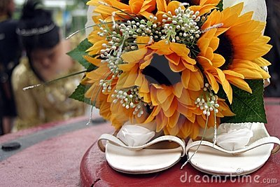 Bride with shoes and flowers