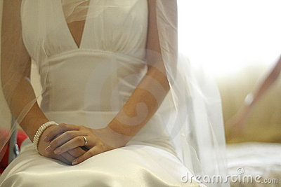 Bride sit down on the bed