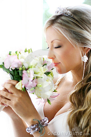 Bride smelling the bouquet