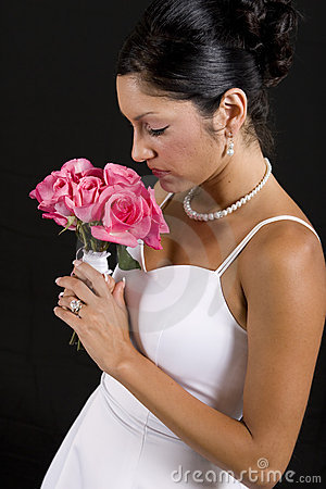 Bride smelling flower bouquet