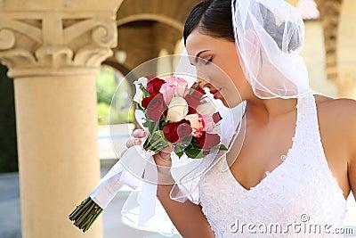 Bride smelling wedding bouquet