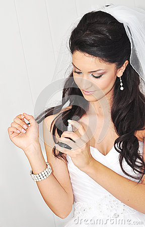 Bride spraying perfume