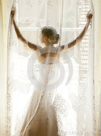 The bride standing on the window