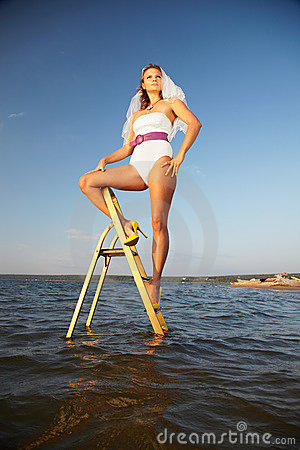 Bride on stepladder