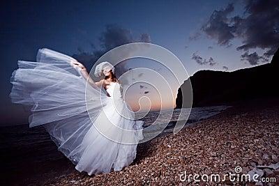 Bride on sunset beach