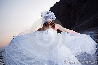Bride on sunset beach