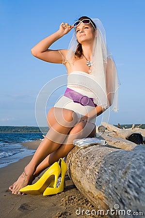 Bride in swimsuit on the sea coast
