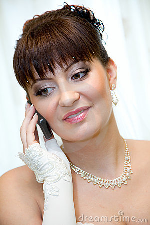 Bride talking on mobile phone