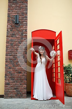 Bride in the telephone cabin