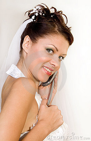 Bride with telephone on a white background
