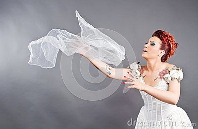 Bride throwing her veil