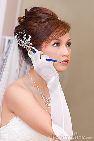 Bride to be talking on cell phone