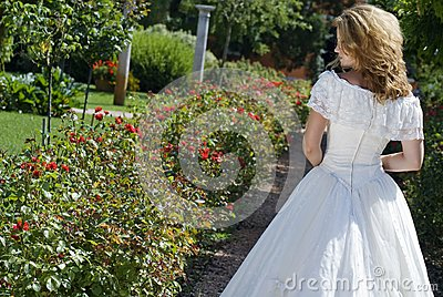 Bride walking along an alley