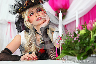 Bride wearing black net gloves and unusual hat