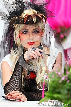 Bride wearing black net gloves and unusual hat
