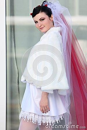 Bride wearing in short dress