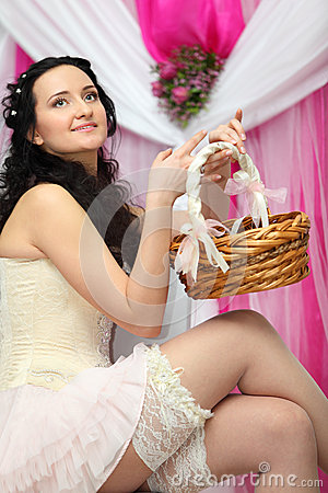 Bride wearing short dress and holds basket