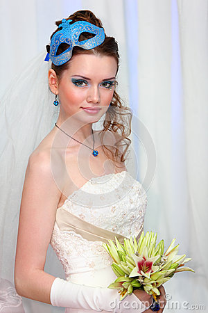 Bride wearing in white dress with blue makeup