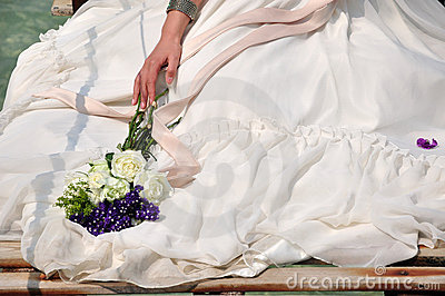 Bride in wedding dress and bouquet