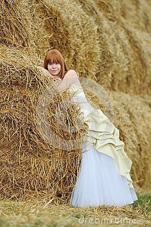 Bride in wedding dress in a field