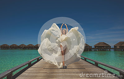 Bride in wedding dress in the Maldives