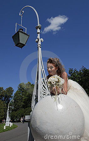 The bride in a wedding dress on a sphere.