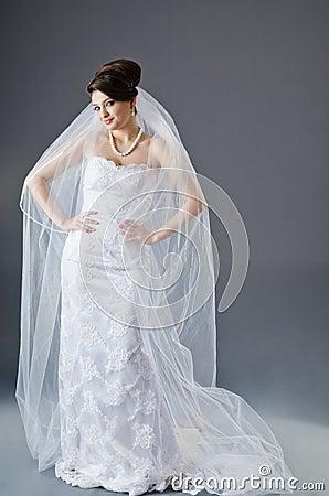 Bride in wedding dress in studio