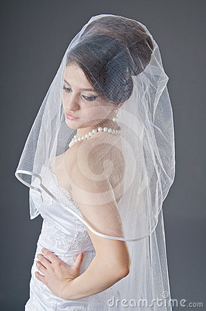Bride in wedding dress in studio