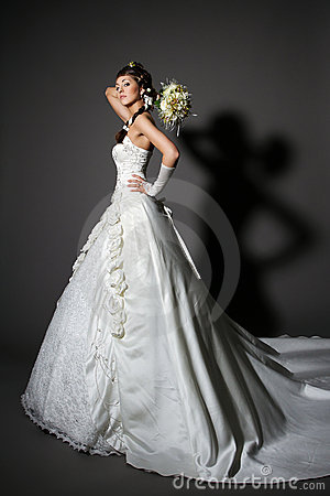 Bride in white elegance wedding dress with tail.